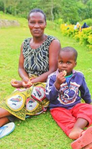 the-small-things-charity-woman-and-boy-sitting-on-grass